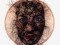 No title-selfpotrait (2004) Transferprint and horsehair on leather (26,5 cm)